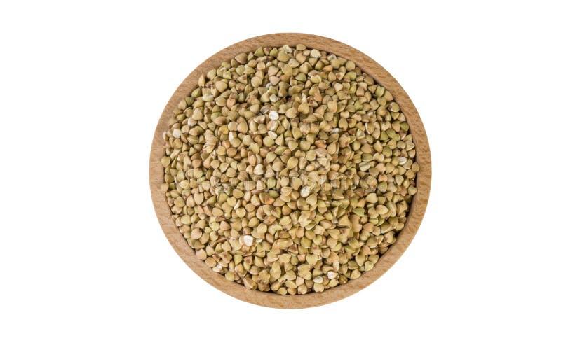 Ακατέργαστο φαγόπυρο στο ξύλινο κύπελλο που απομονώνεται στο άσπρο υπόβαθρο διατροφή συστατικό τροφίμων r στοκ εικόνες