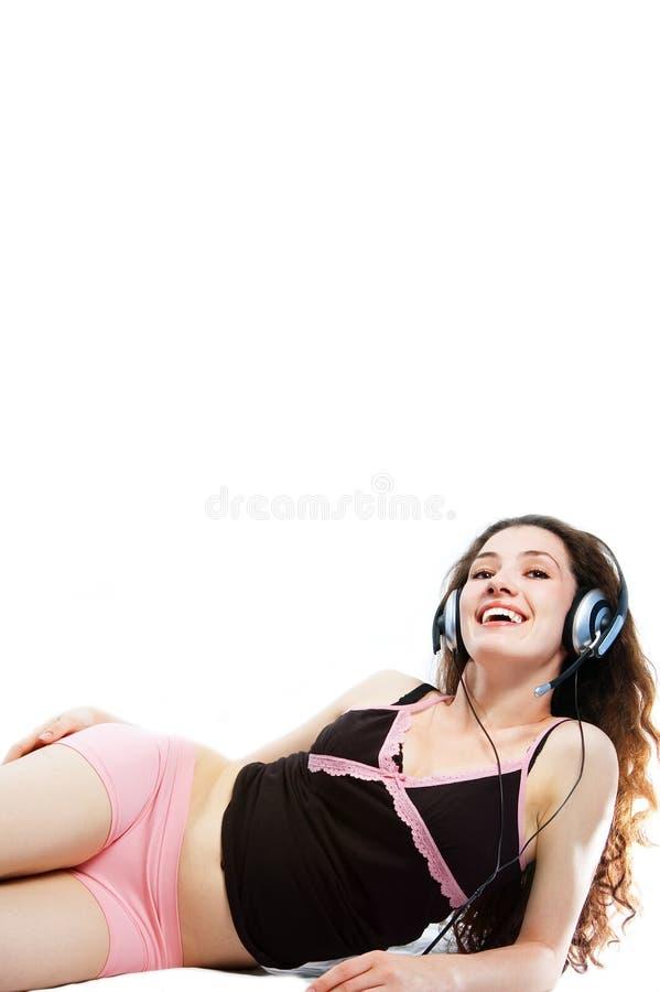 ακουστικά 1 κοριτσιού στοκ εικόνα