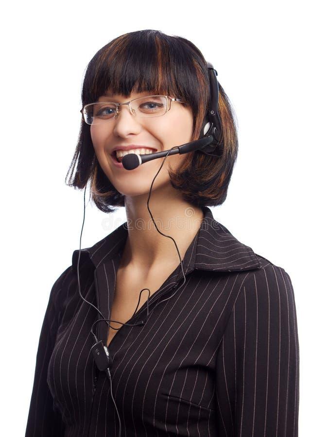 ακουστικό brunette που χαμογ&epsilo στοκ εικόνα