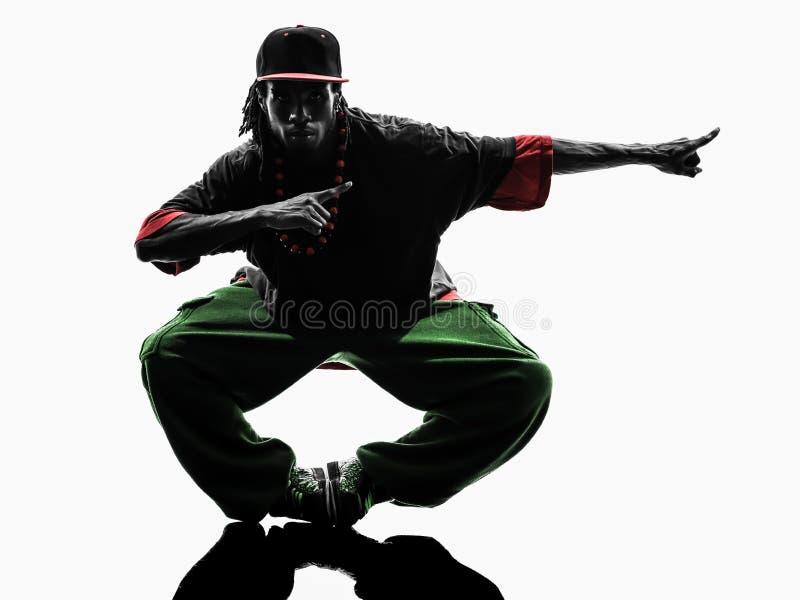 Ακροβατικός χορευτής σπασιμάτων χιπ χοπ που η σκιαγραφία νεαρών άνδρων στοκ εικόνες