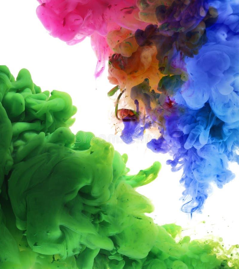 Ακρυλικά χρώματα στο νερό αφηρημένη ανασκόπηση στοκ εικόνες