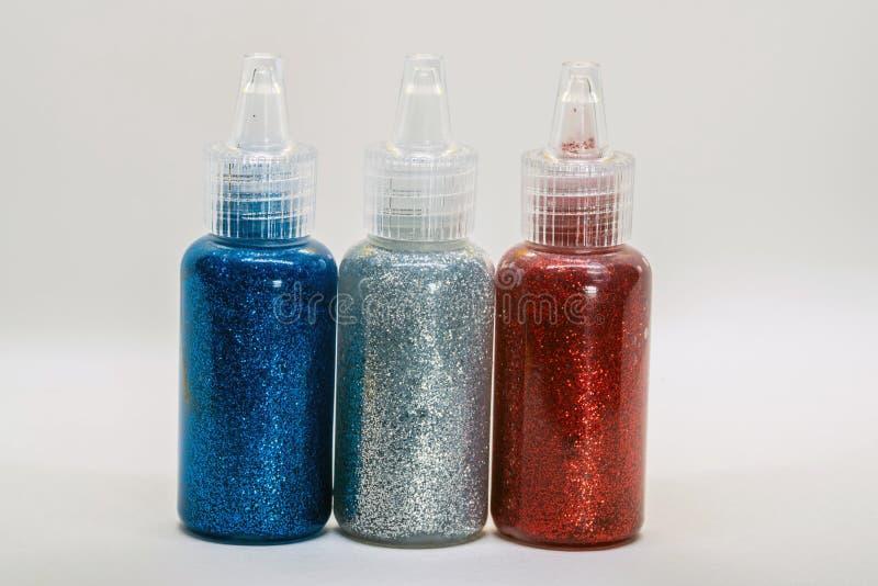 Ακτινοβολώντας μπουκάλια με την κόλλα στοκ φωτογραφία με δικαίωμα ελεύθερης χρήσης