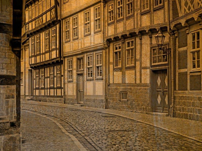 Αλέα με τα εφοδιασμένα με ξύλα σπίτια στην παλαιά πόλη Quedlinburg στο αναδρομικό βλέμμα στοκ φωτογραφία