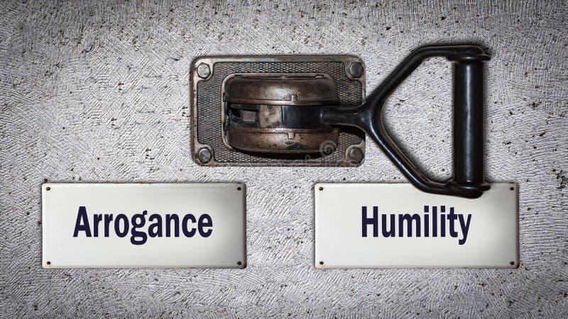 Αλλαγή τοίχων στην ταπεινότητα εναντίον της υπεροψίας στοκ φωτογραφίες