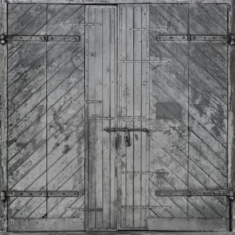 Αμαυρωμένη ξύλινη πόρτα στοκ εικόνες