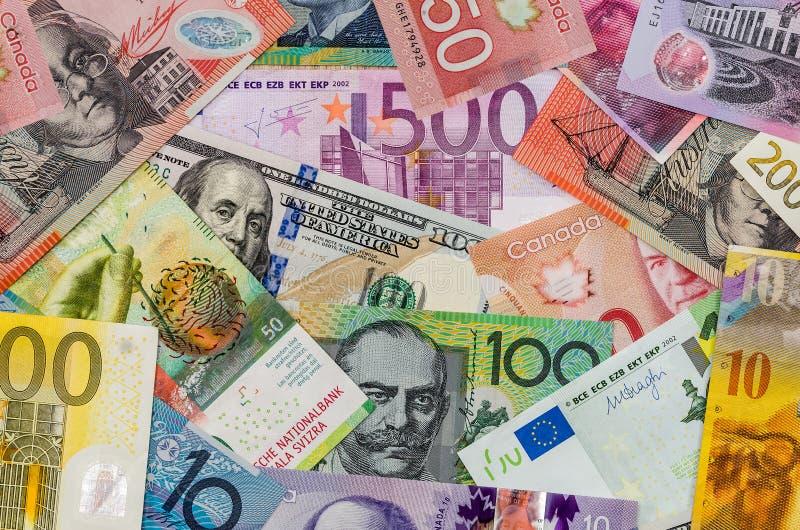 Αμερικανικά δολάρια, ευρωπαϊκό ευρο-, ελβετικό φράγκο, καναδικό δολάριο, αυστραλιανό δολάριο στοκ εικόνες