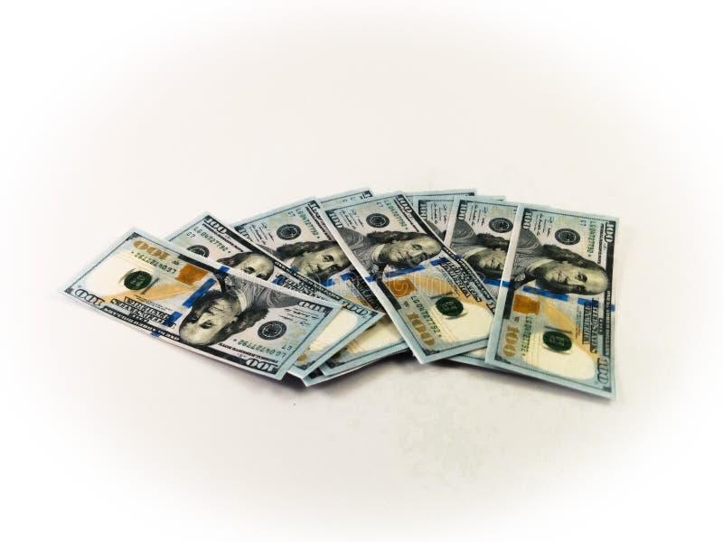 100 αμερικανικά δολάρια που διαδίδονται γύρω στοκ φωτογραφίες