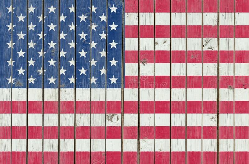 ΑΜΕΡΙΚΑΝΙΚΗ σημαία που χρωματίζεται στον ξύλινο φράκτη, αμερικανικό υπόβαθρο απεικόνιση αποθεμάτων