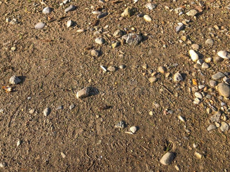 Αμμοχάλικο, χαλίκια και άνευ ραφής υπόβαθρο κινηματογραφήσεων σε πρώτο πλάνο άμμου στοκ εικόνες