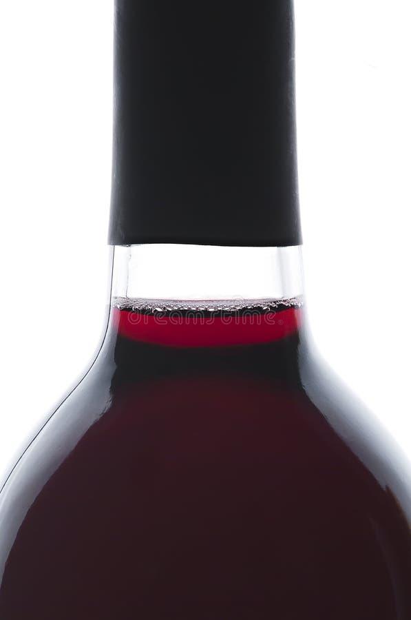 αναδρομικά φωτισμένο κόκκινο ενιαίο κρασί μπουκαλιών στοκ εικόνες