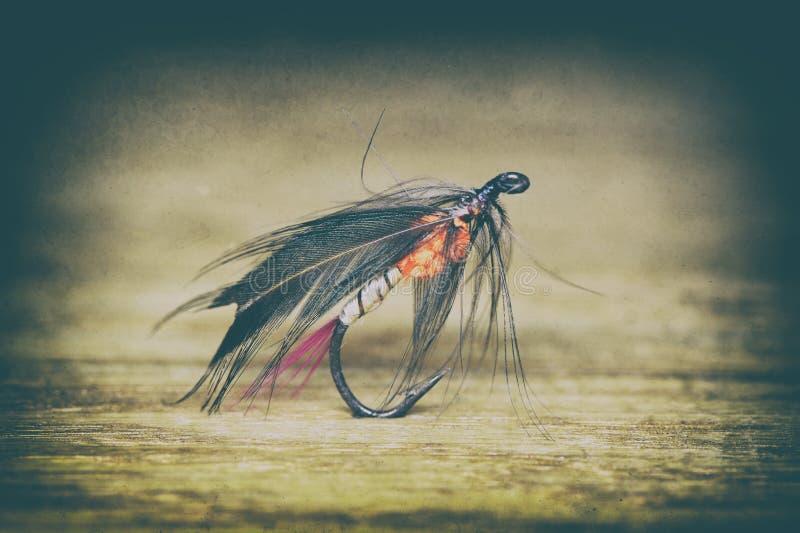 Αναδρομικό ύφος θελγήτρου αλιείας μυγών στοκ εικόνα με δικαίωμα ελεύθερης χρήσης