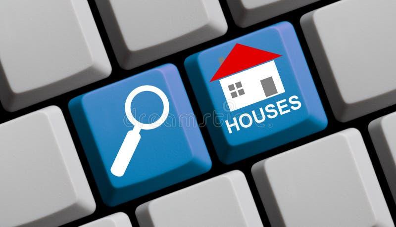 Αναζήτηση των σπιτιών on-line στοκ εικόνα με δικαίωμα ελεύθερης χρήσης