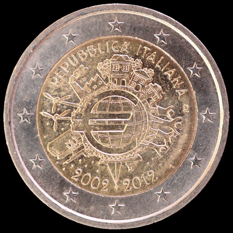 Αναμνηστικό ευρο- νόμισμα δύο που εκδίδεται από την Ιταλία το 2012 και γιορτάζοντας τα δέκα έτη του ευρώ στοκ εικόνα