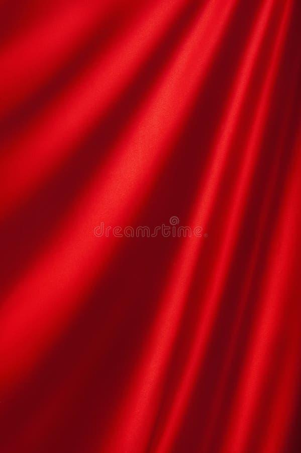 Ανασκόπηση από ένα κόκκινο κλωστοϋφαντουργικό προϊόν στοκ φωτογραφίες