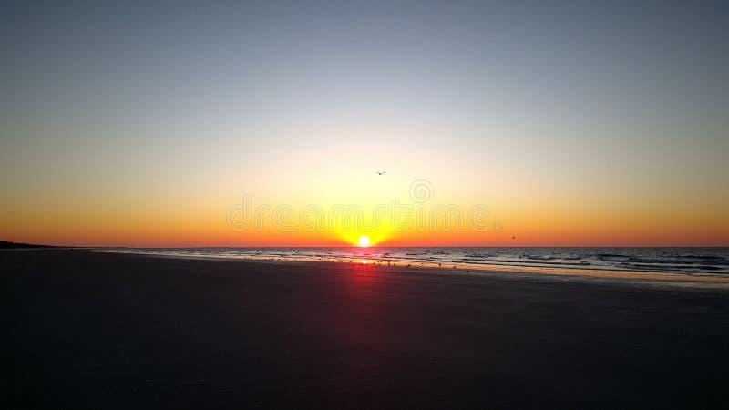 Ανατολή στην παραλία αλσών κερασιών στοκ φωτογραφίες