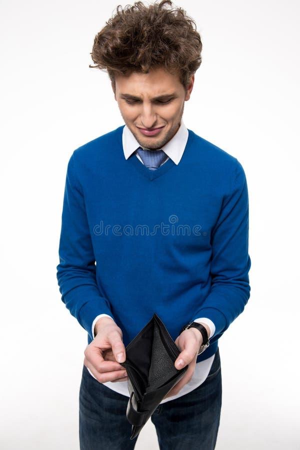 Ανατρέψτε το νεαρό άνδρα που κρατά το emty πορτοφόλι στοκ φωτογραφία με δικαίωμα ελεύθερης χρήσης