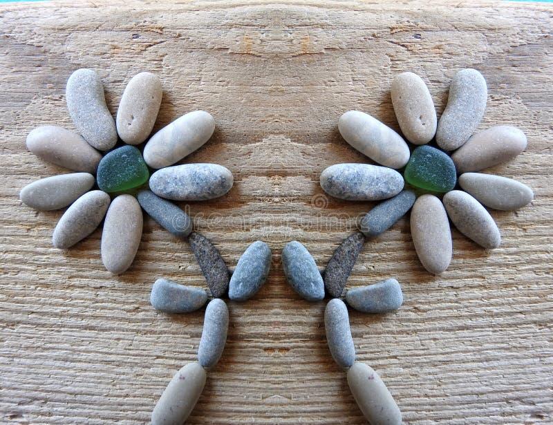 Ανθίζει καμένος χρησιμοποιώντας τις πέτρες θάλασσας στοκ φωτογραφίες