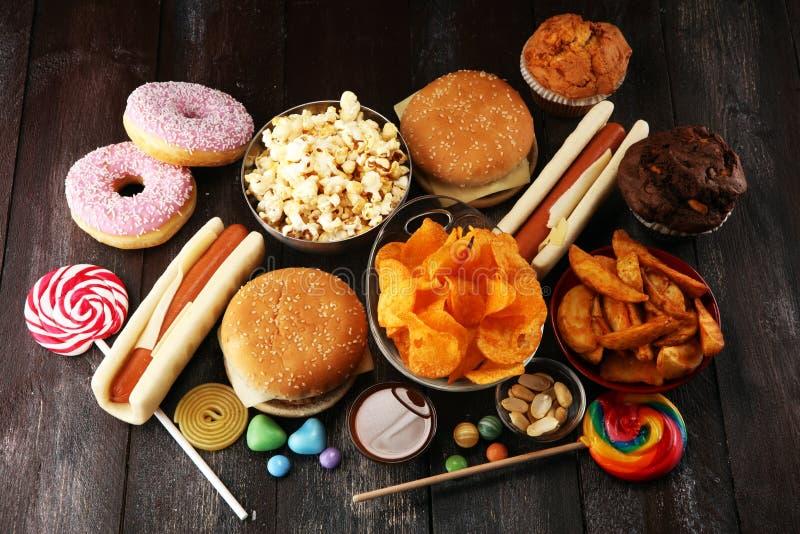 Ανθυγειινά προϊόντα τρόφιμα κακά για τον αριθμό, το δέρμα, την καρδιά και τα δόντια στοκ εικόνες