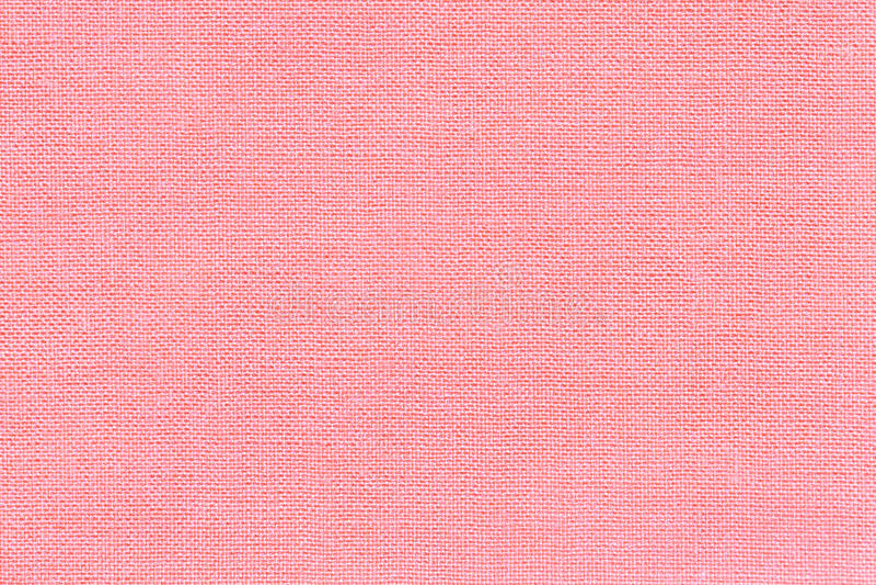 Ανοικτό ροζ υπόβαθρο από ένα υφαντικό υλικό με το ψάθινο σχέδιο, κινηματογράφηση σε πρώτο πλάνο στοκ φωτογραφία
