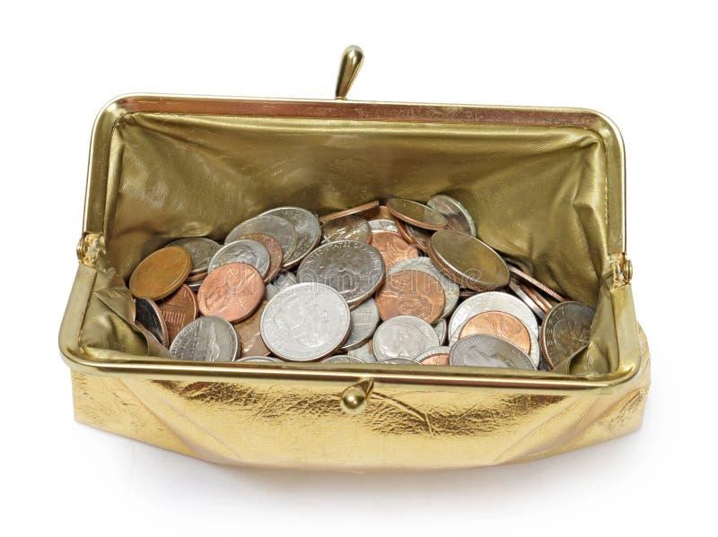 Ανοικτό χρυσό μεταλλικό πορτοφόλι νομισμάτων υπερυψωμένο με τη σκιά στοκ εικόνες