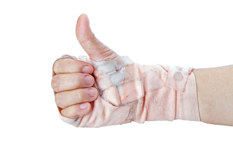 Αντίχειρας που παρουσιάζει με το χέρι με τους επιδέσμους που απομονώνονται στο λευκό στοκ εικόνα με δικαίωμα ελεύθερης χρήσης