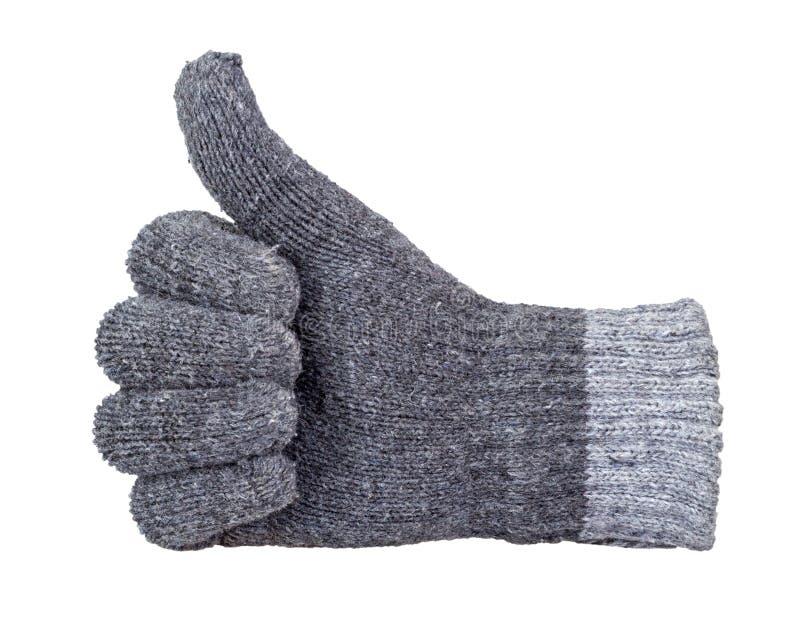 Αντίχειρας που παρουσιάζει με το χέρι το γκρίζο πλέκοντας γάντι μαλλιού που απομονώνεται με στοκ εικόνες με δικαίωμα ελεύθερης χρήσης