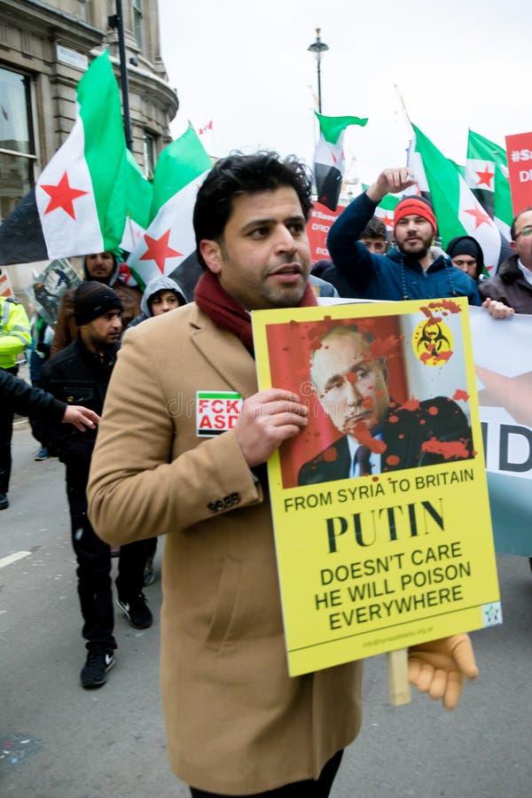 Αντι συριακοί διαμαρτυρόμενοι Μάρτιος Προέδρου Assad στο κεντρικό Λονδίνο στοκ εικόνα με δικαίωμα ελεύθερης χρήσης