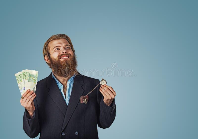 Αντλώντας πυγμές ατόμων που κρατούν το ρολόι χρημάτων και τσεπών στοκ εικόνες