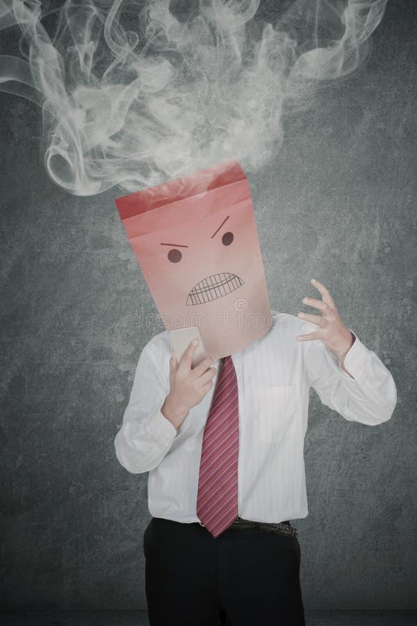 Ανώνυμος επιχειρηματίας με τον καπνό πέρα από το κεφάλι του στοκ φωτογραφία με δικαίωμα ελεύθερης χρήσης