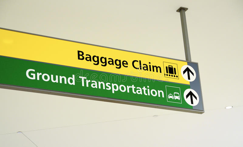Αξίωση αποσκευών και αλεσμένο σημάδι μεταφορών στοκ φωτογραφία με δικαίωμα ελεύθερης χρήσης