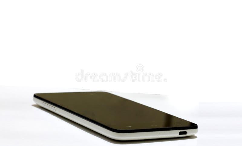 Απομονωμένη εικόνα ενός γραπτού κινητού τηλεφώνου στοκ φωτογραφία