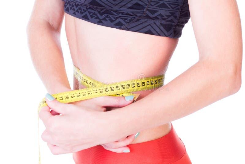 απομονωμένη λευκή γυναίκα βάρους κορμών μέτρου απώλειας στοκ φωτογραφία με δικαίωμα ελεύθερης χρήσης