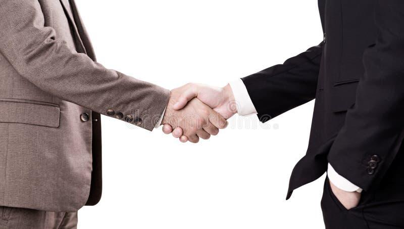 Απομονωμένοι επιχειρηματίες που τινάζουν τα χέρια στοκ εικόνες