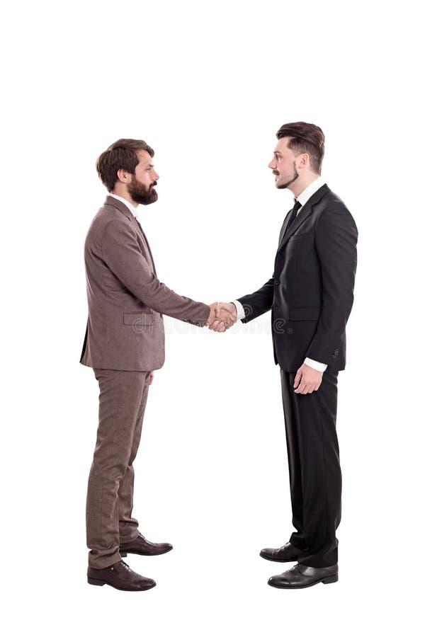 Απομονωμένοι επιχειρηματίες που τινάζουν τα χέρια στοκ φωτογραφία