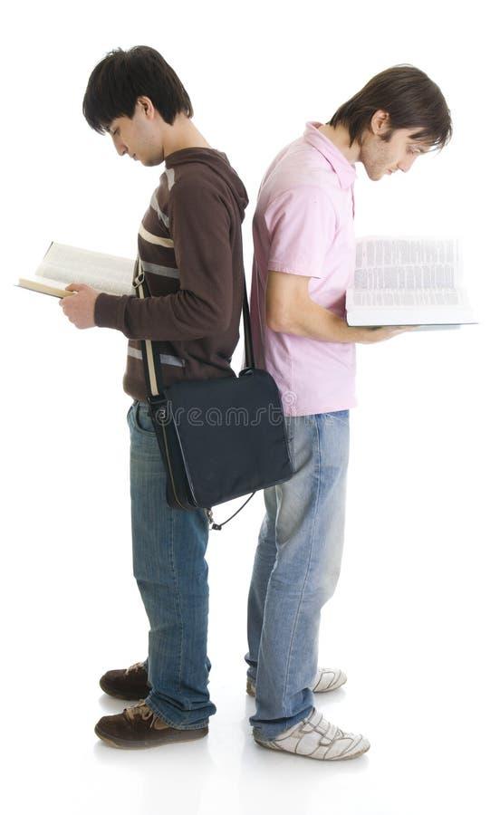 απομονωμένοι σπουδαστές δύο λευκές νεολαίες στοκ φωτογραφία με δικαίωμα ελεύθερης χρήσης
