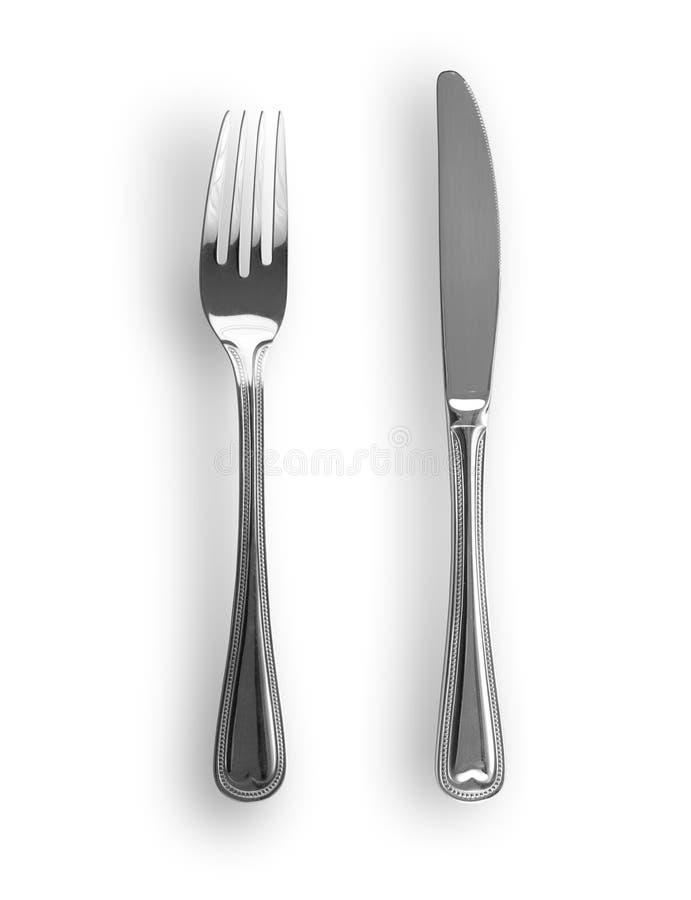 απομονωμένο δίκρανο μαχαί&r στοκ φωτογραφία