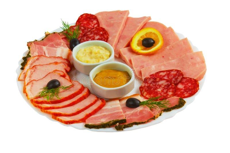 Απομονωμένο μουστάρδα πιάτο ζαμπόν τροφίμων τεμαχισμένο λουκάνικο επάνω στοκ εικόνες
