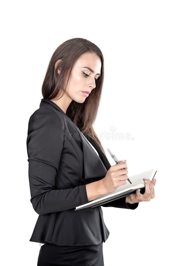Απομονωμένο πορτρέτο μιας επιχειρηματία με τον αρμόδιο για το σχεδιασμό στοκ φωτογραφίες με δικαίωμα ελεύθερης χρήσης
