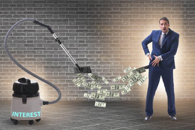 Απορροφώντας χρήματα επιχειρηματιών και ηλεκτρικών σκουπών από τον στοκ φωτογραφίες με δικαίωμα ελεύθερης χρήσης