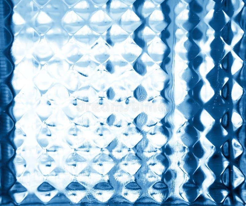 Αποτυπωμένο σε ανάγλυφο γυαλί σχέδιο στους μπλε τόνους. Ανακούφιση γυαλιού. στοκ εικόνα με δικαίωμα ελεύθερης χρήσης