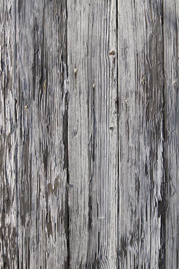 Αποφλοίωση χρωμάτων μακρυά από το στενό ξύλινο πίνακα στοκ φωτογραφίες