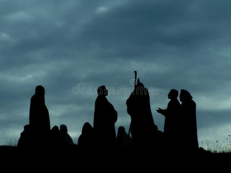 Απόστολοι που μιλούν τη Βίβλο του Ιησού θρησκείας στοκ φωτογραφία