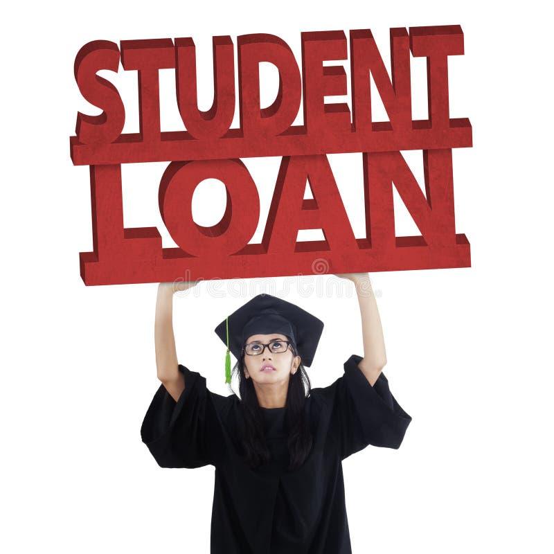 Απόφοιτος φοιτητής με το κείμενο δανείου σπουδαστών στοκ φωτογραφίες