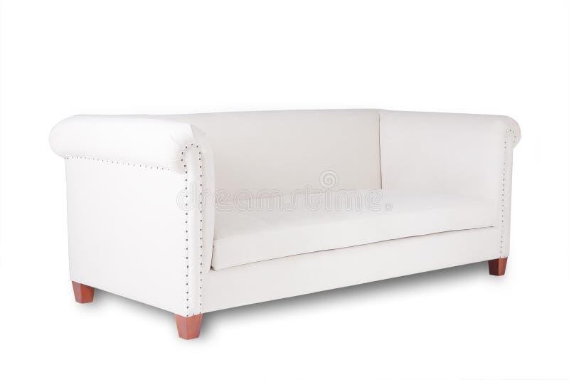 Απλός άσπρος καναπές σε ένα άσπρο υπόβαθρο στοκ φωτογραφία