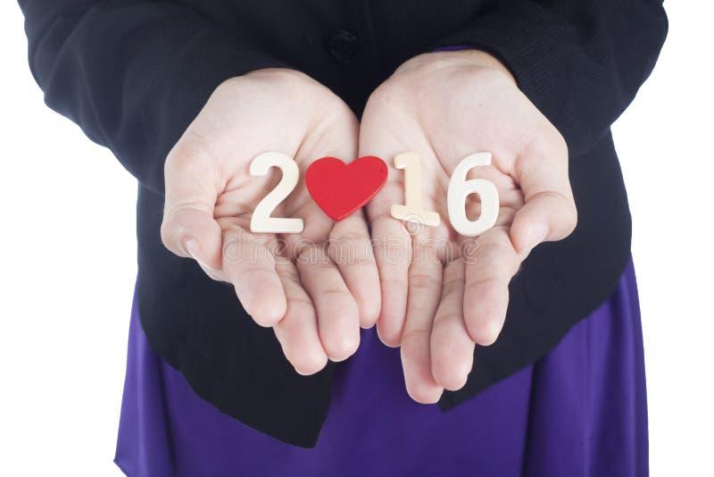 2016 αριθμοί στην παλάμη του όμορφου χεριού στοκ εικόνα