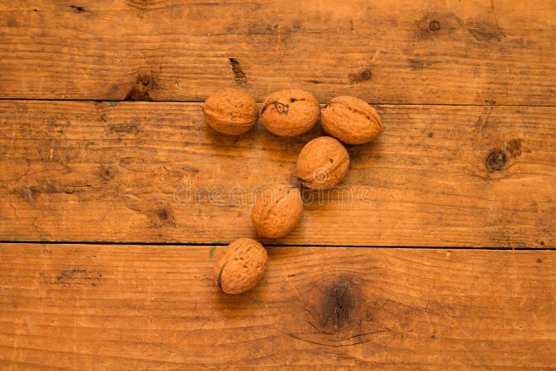 Αριθμός 7 από τα ξύλα καρυδιάς στοκ φωτογραφίες