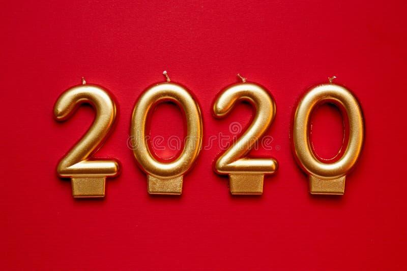 Αριθμός-διαμορφωμένα κεριά που διαμορφώνουν τους χρυσούς αριθμούς για το νέο έτος του 2020 στοκ φωτογραφία με δικαίωμα ελεύθερης χρήσης