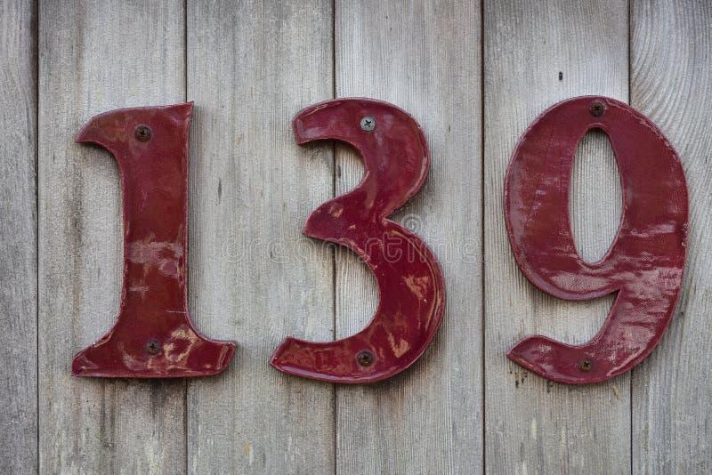 Αριθμός σπιτιών στον ξύλινο τοίχο στοκ εικόνες με δικαίωμα ελεύθερης χρήσης
