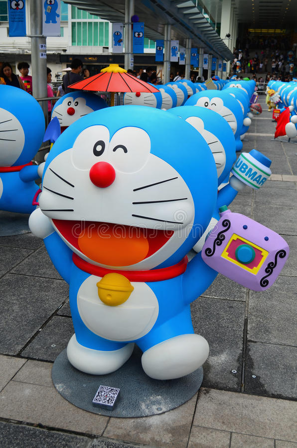 Αριθμός Doraemon με τα ενδύματα που αλλάζουν τη φωτογραφική μηχανή στοκ εικόνες με δικαίωμα ελεύθερης χρήσης