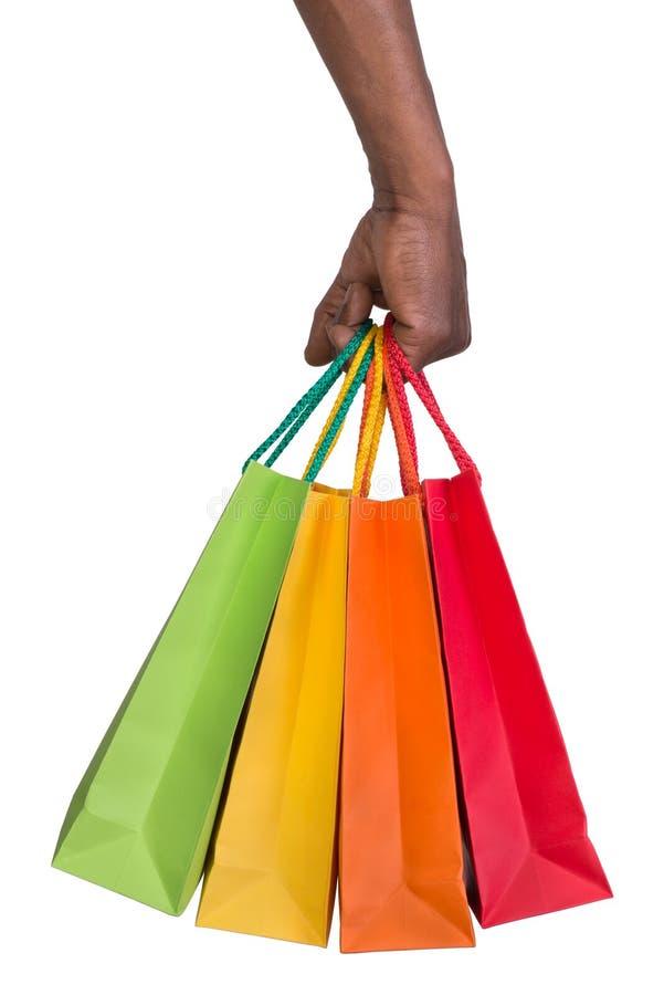 Αρσενικές τσάντες αγορών εκμετάλλευσης χεριών στοκ εικόνες